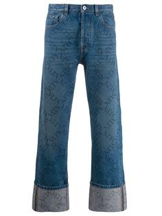 Valentino джинсы с логотипом VLTN и подворотами