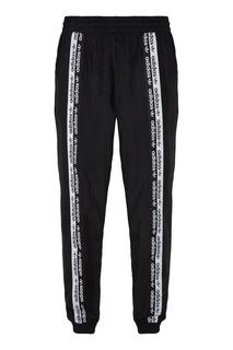 Черно-белые брюки с брендированной тесьмой Adidas