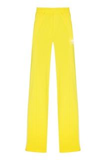 Желтые брюки Firebird Adidas