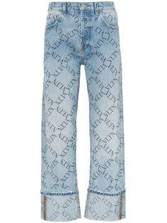 Valentino джинсы с логотипами и подворотами
