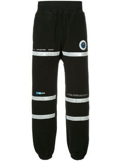 Undercover спортивные брюки с заплаткой Astronautics Agency
