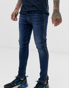 Темно-синие эластичные джинсы с напылением и молниями по бокам ASOS DESIGN - Синий