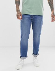 Светлые классические джинсы с суженными книзу штанинами Levis 502 - cedar light mid overt - Синий