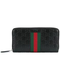 Gucci монограммный бумажник на молнии