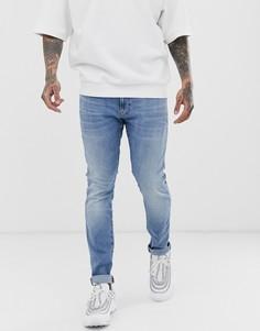 Облегающие джинсы с легкой потертой отделкой G-Star Revend - Синий