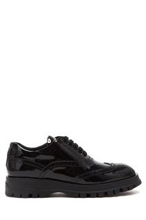 Черные ботинки с перфорацией Prada