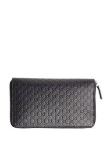 Черный кожаный клатч с тисненым мотивом GG Gucci