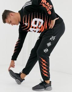 Черные спортивные брюки с принтом adidas Training GRFX