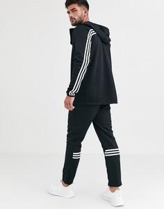 Черные брюки с полосками adidas Training