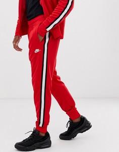 Красные спортивные джоггеры Nike Tribute