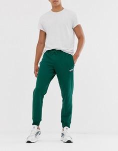 Зеленые джоггеры с принтом логотипа adidas Originals