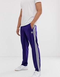 Фиолетовые спортивные штаны adidas Originals firebird