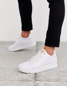Белые кроссовки с тисненым логотипом SikSilk