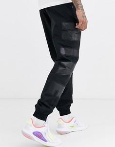Черные джоггеры с манжетами и логотипом Nike Social Currency