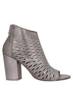Полусапоги и высокие ботинки Silvia Carasi