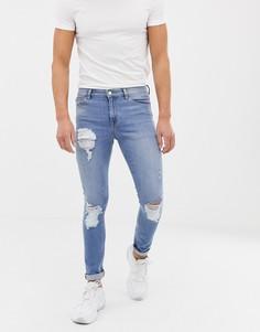 Светлые джинсы скинни из денима 12,5 унц с рваной отделкой ASOS DESIGN-Синий