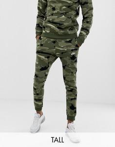 Зеленые джоггеры с камуфляжным принтом Nike Tall Club AJ2111-325-Зеленый