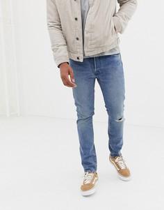 Светлые джинсы скинни с классической талией и дыркой на колене Levis 501-Синий