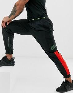 Черные суженные спортивные брюки Nike Training-Черный