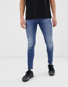 Выбеленные синие эластичные джинсы с напылением ASOS DESIGN-Синий