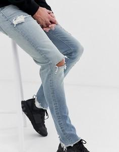 Светлые рваные джинсы скинни ASOS DESIGN-Синий