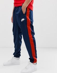 Темно-синие спортивные штаны с логотипом и полосками по бокам Nike-Темно-синий
