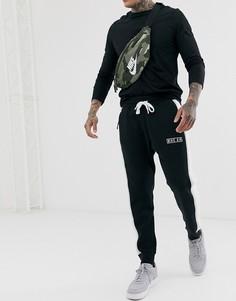 Черные спортивные штаны с логотипом и контрастной полосой Nike-Черный