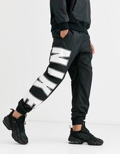 Черные джоггеры с кромкой манжетом и крупным логотипом Nike-Черный