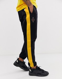 Черные спортивные штаны с логотипом и полосками по бокам Nike-Черный
