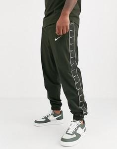 Джоггеры цвета хаки с манжетами и отделкой лентой Nike-Зеленый