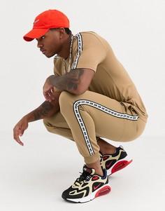 Джоггеры песочного цвета с манжетами и отделкой лентой Nike-Светло-бежевый