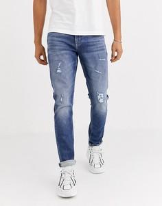 Синие облегающие суженные книзу джинсы Calvin Klein Jeans-Синий