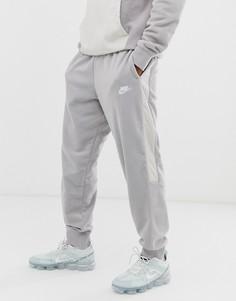 Серые зимние джоггеры со вставками Nike-Серый