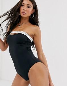 Черный слитный купальник с вырезом и логотипом Calvin Klein