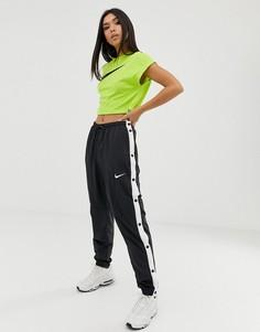 Черно-белые спортивные штаны с кнопками Nike-Мульти