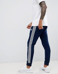 Темно-синие облегающие джоггеры с 3 полосками по бокам и манжетами adidas Originals DH5834-Темно-синий