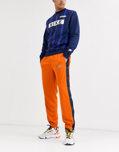 Оранжевые джоггеры с кнопками Nike Heritage-Оранжевый