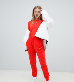 Красные спортивные штаны с логотипом-галочкой Nike эксклюзивно для ASOS-Красный