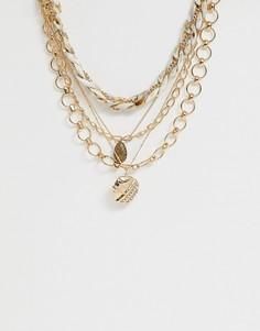 Золотистое ожерелье в несколько рядов с элементами из резины, цепочками разных дизайнов и подвесками-монетами с состаренным эффектом ASOS DESIGN-Золотой