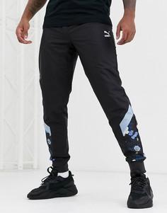 Спортивные брюки с цветочным принтом Puma-Черный