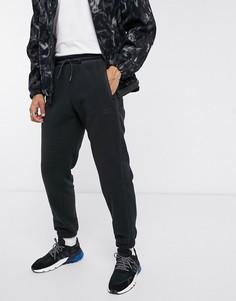 Черные флисовые джоггеры со светоотражающей отделкой adidas originals-Черный