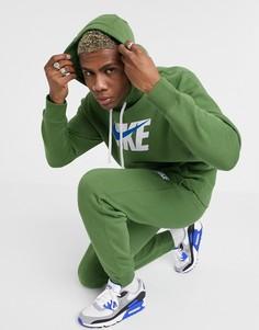 Зеленый спортивный костюм с капюшоном Nike