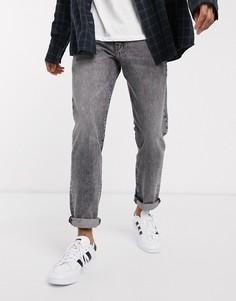 Черные суженные книзу джинсы с эффектом кислотной стирки Levis 502-Черный