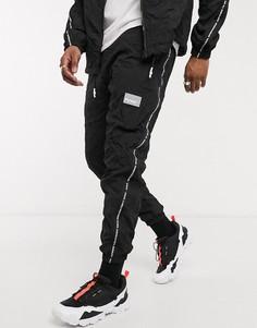 Черные джоггеры с фирменной тесьмой Puma-Черный