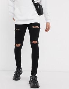 Черные джинсы с рваной отделкой ASOS DESIGN-Черный