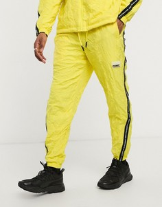 Желтые джоггеры с фирменной тесьмой Puma Evide-Зеленый