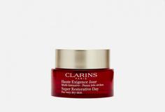 Восстанавливающий дневной крем для сухой кожи Clarins