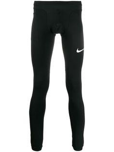 Nike компрессионные тайтсы с логотипом