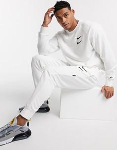 Белые джоггеры с манжетами и логотипом-галочкойNike-Белый