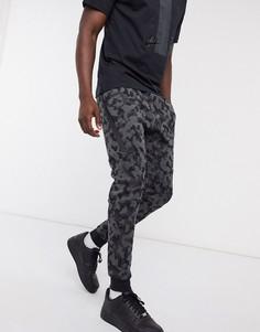 Черные джоггеры со сплошным принтом Nike Tech Fleece-Черный
